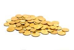 les pièces de monnaie divisent en lots le blanc Photographie stock