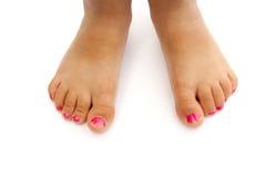 Les pieds de l'enfant avec le nailpolish Photographie stock