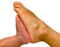 Les pieds du frère Photographie stock