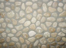 Les pierres ont placé dans un mur avec la colle Photographie stock