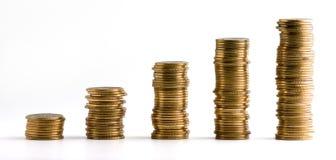 Les piles de pièces de monnaie ont isolé photos libres de droits