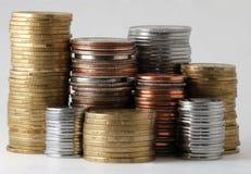 Les piles des pièces de monnaie Photographie stock libre de droits