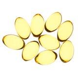 Les pilules jaunes ont isolé le fond Image stock