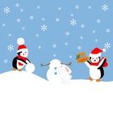 Les pingouins construisent un bonhomme de neige illustration de vecteur