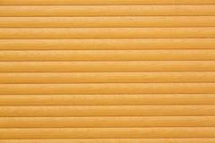 Les planches en bois horizontales ont peint jaune ou beige comme fond ou texture pour votre projet de conception photo libre de droits