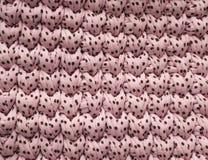 Les points roses de coton de plan rapproché tricotent l'atmosphère de couverture, chaude et confortable Tricotez le fond photo libre de droits
