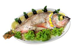 Les poissons cuits au four ont isolé Photos libres de droits