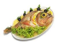 Les poissons cuits au four ont isolé Photos stock