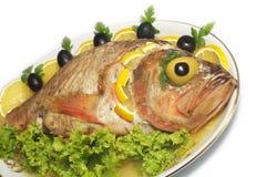 Les poissons cuits au four ont isolé Image libre de droits
