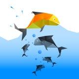 Les poissons sautent au-dessus d'autres poissons Image stock