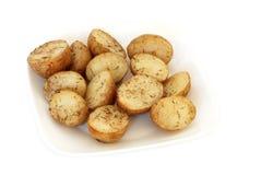 les pommes de terre ont rôti le romarin Photos stock