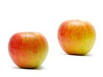 les pommes ont isolé le rouge Photo stock
