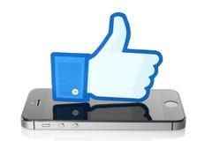 Les pouces de Facebook se connectent l'iPhone sur le fond blanc Image stock