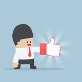 Les pouces de port d'homme d'affaires lèvent des gants Image stock