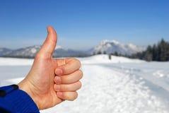 Les pouces lèvent l'hiver Photo stock