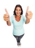 Les pouces modernes de sourire drôles lèvent la femme Image libre de droits