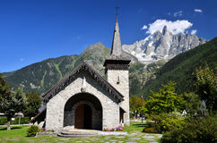 Les Praz de Chamonix and Aiguille Dru mountain Stock Photography