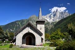 Les Praz de Chamonix and Aiguille Dru mountain. Les Praz de Chamonix medieval church and Aiguille Dru mountain in Alps Stock Photography