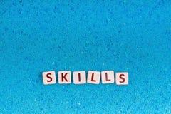 Les qualifications expriment sur la pierre Photo stock