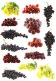 Les raisins ont placé d'isolement. Photographie stock