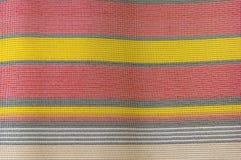 Les rayures de tissu donnent au fond une consistance rugueuse image stock