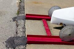 Les roues avant d'un savon enferment dans une boîte le coureur de Derby Photo libre de droits