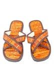 Les sandales de bascule électronique échouent des chaussures sur le fond blanc Photos stock