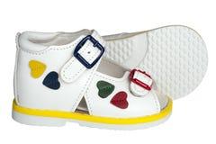 Les sandales des enfants blancs Images libres de droits