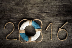 Les schémas 2016 sur le vieux fond en bois gris dans le style de mer avec courtisent Photo stock