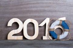 Les schémas 2016 sur le vieux fond en bois gris dans le style de mer avec courtisent Photos stock