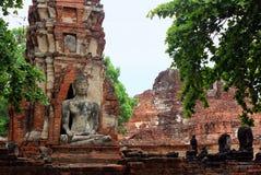 Les sculptures en Bouddha ont fait de la roche dans les ruines de temple de Wat Phra Sri Sanphet Ayutthaya, Tha?lande image libre de droits