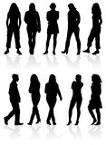 Les silhouettes équipent et des femmes Photo stock