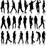 Les silhouettes noires de beau équipe et la femme dessus Photographie stock libre de droits