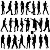 Les silhouettes noires de beau équipe et la femme dessus Photo libre de droits