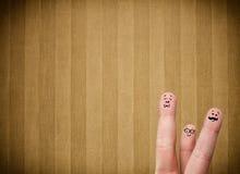 Les smiley heureux de doigt avec la rayure de vintage wallpaper le fond Images stock