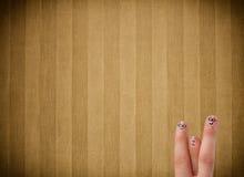 Les smiley heureux de doigt avec la rayure de vintage wallpaper le fond Photo libre de droits