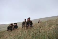Les soldats s'exerçant dans le Brecon balise, le sud du pays de Galles Images libres de droits