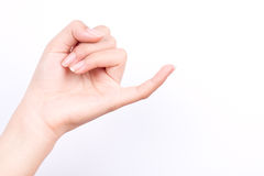 Les symboles de fille de main de doigt ont isolé le crochet de concept et x27 ; auriculaire de s il est moyen réconcilier ou prom Photos stock