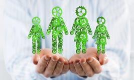 Les symboles verts des membres de la famille en tant qu'un mécanisme ont présenté dans des paumes de l'homme Photos stock