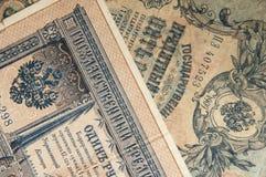 Les temps russes et vieux antiques de billets de banque du papier peint de Nicholas 2 de tsar Photo stock