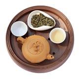 Thé-choses d'argile et thé vert Photographie stock libre de droits