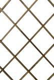 Les tiges en bois dans une cage sur un blanc ont isolé le fond photographie stock libre de droits