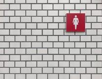 Les toilettes rouges de femme se connectent le mur blanc de carreau de céramique Photo stock