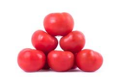 Les tomates rouges mûres ont isolé Photo stock