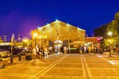 Les touristes apprécient l'atmosphère de Mallory Square après coucher du soleil Photo stock