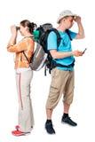 Les touristes de marche Lost regardent dans différentes directions sur un blanc Photographie stock