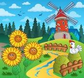 Les tournesols s'approchent du moulin à vent Image stock