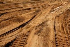 Les traces transportent le sable technique Image stock