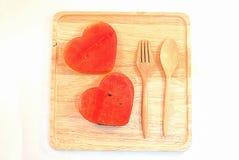 Les tranches fraîches de pastèque dans le coeur forment Images libres de droits