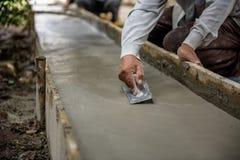Les travailleurs de la construction de la Thaïlande plâtraient Photographie stock